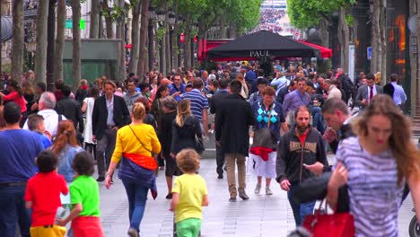 Crowds-of-people-walk-on-the-streets-of-Paris-France