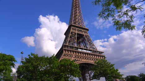 Tilt-up-of-the-Eiffel-Tower-in-Paris-with-beautiful-clouds