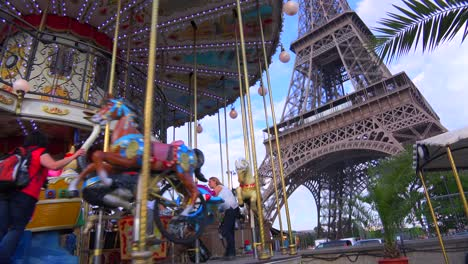 Tilt-up-from-a-Merry-Go-Round-to-the-Eiffel-Tower-Paris