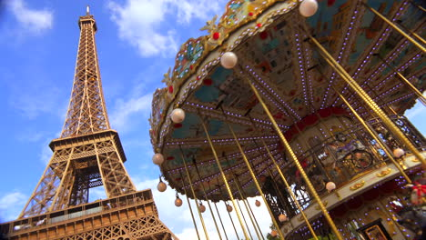 The-Eiffel-Tower-rises-behind-a-merry-go-round-in-Paris-France