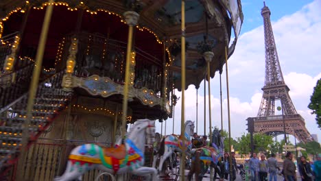 A-Merry-Go-Round-turns-near-the-Eiffel-Tower-Paris