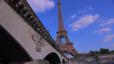 Point-of-view-from-a-riverboat-passing-under-a-bridge-of-the-Eiffel-Tower-Paris