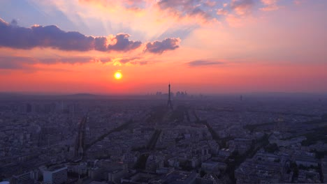 Gorgeous-high-angle-view-of-the-Eiffel-Tower-and-Paris-at-sunset-1