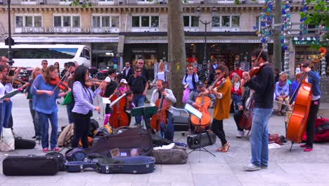 A-symphony-orchestra-in-street-clothes-plays-music-on-the-streets-of-Paris