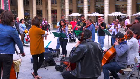 A-symphony-orchestra-in-street-clothes-plays-music-on-the-streets-of-Paris-1
