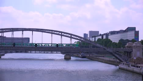 A-subway-train-crosses-a-bridge-over-the-Seine-in-Paris