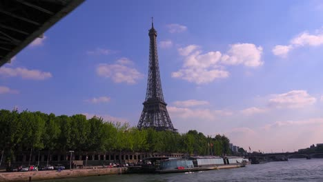 A-point-of-view-of-the-Eiffel-Tower-from-a-bateaux-mouche-riverboat-traveling-along-the-Seine-River-in-Paris