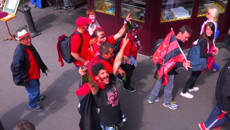 Rowdy-football-fans-celebrate-on-a-city-street-in-Europe