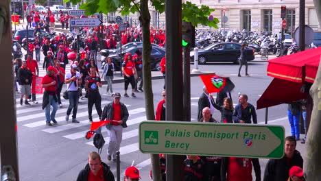 Rowdy-football-fans-celebrate-on-a-city-street-in-Europe-1