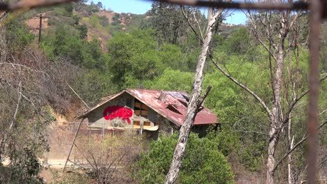 A-rundown-and-scary-cabin-in-the-hills-is-seen-from-a-distance-1