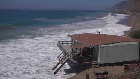 A-building-along-the-Malibu-coastline-collapses-into-the-sea-after-a-major-storm-surge