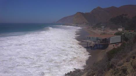 A-house-along-the-Malibu-coastline-collapses-into-the-sea-after-a-major-storm-surge-1