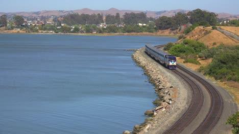 An-Amtrak-train-passes-along-a-shoreline-in-the-Bay-Area-of-California-1