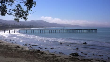 A-beautiful-pier-juts-out-into-the-ocean-along-the-California-Coast