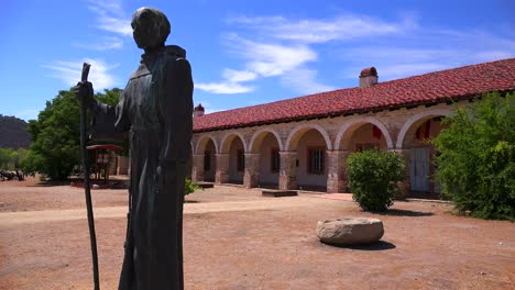 A-statue-of-Father-Junipero-Serra-stands-in-front-of-a-California-Mission