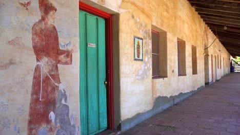 Murals-line-the-adobe-walls-of-a-California-Mission