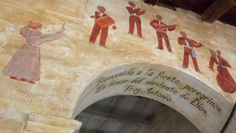 Murals-line-the-adobe-walls-of-a-California-Mission-1