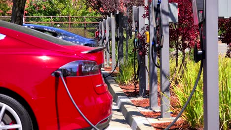 A-Tesla-electric-car-charges-at-a-charging-station