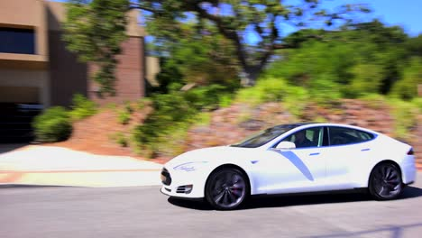 A-Tesla-electric-car-passes-in-front-of-Tesla-corporate-headquarters