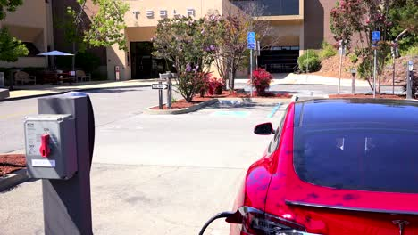 A-Tesla-electric-car-charging-in-front-of-Tesla-corporate-headquarters-1