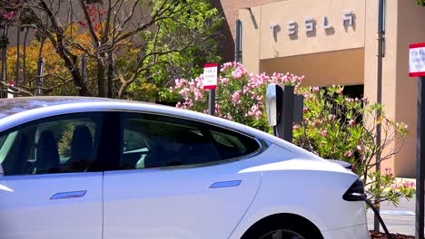 A-Tesla-electric-car-charging-in-front-of-Tesla-corporate-headquarters-2