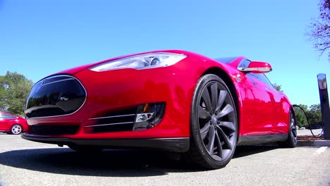 Traveling-shot-around-the-front-of-a-Tesla-electric-car