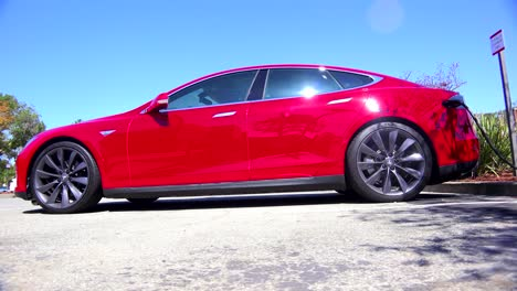 Traveling-shot-along-the-side-of-a-Tesla-electric-car