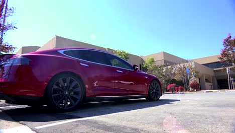 Traveling-shot-along-the-back-of-a-Tesla-electric-car-as-it-charges-2