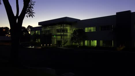 Establishing-shot-of-the-exterior-of-a-generic-modern-office-building-at-night-3