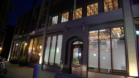 Establishing-shot-of-a-small-retail-business-district-at-night