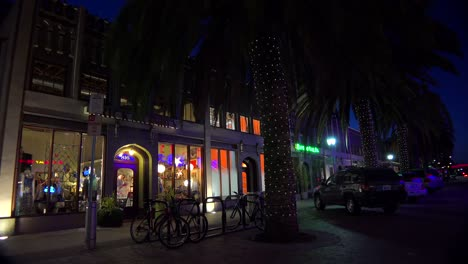 Establishing-shot-of-a-small-retail-business-district-at-night-2