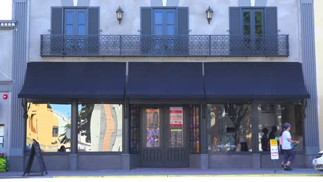 Establishing-shot-of-a-small-retail-storefront-or-music-club