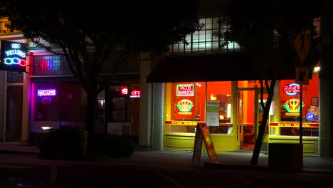 Establishing-shot-of-a-small-retail-storefront-business-district-at-night-1