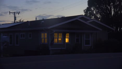 A-1940-s-style-house-with-the-lights-on-at-night