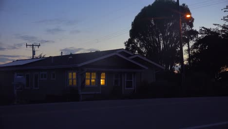 A-1940-s-style-house-with-the-lights-on-at-night-1