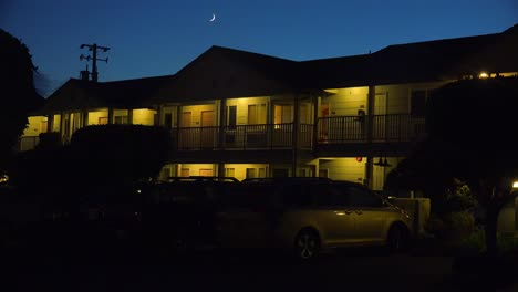 A-modern-economy-hotel-exterior-establishing-shot-at-night