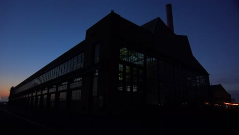 Wide-shot-of-a-large-warehouse-or-factory-at-dusk-or-sunset-4