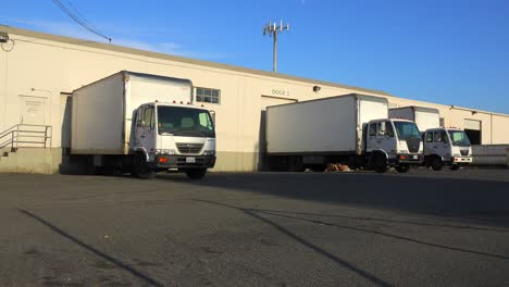 Trucks-are-lined-up-at-a-commercial-warehouse-and-shipping-facility