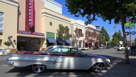 Establishing-shot-of-a-small-retail-business-district-with-a-classic-car-parked-in-front