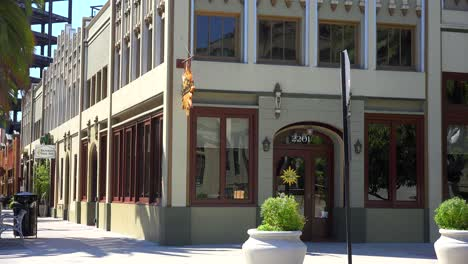 Establishing-shot-of-a-small-retail-business-district-with-shops