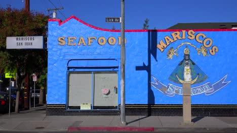 Establishing-shot-of-a-bright-blue-seafood-restaurant