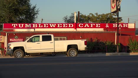 The-lonely-Tumbleweed-Cafe-truck-stop-bar-and-cafe-along-a-remote-desert-highway-with-pickup-truck-in-front