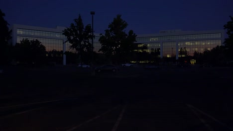 Establishing-shot-of-the-exterior-of-a-generic-modern-corporate-office-building-at-night
