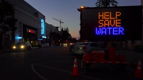 A-highway-sign-warns-of-serious-drought-and-urges-people-to-help-save-water-in-California