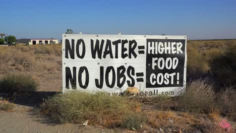A-road-sign-warns-of-s-serious-drought-and-the-cost-to-California-in-jobs-and-food