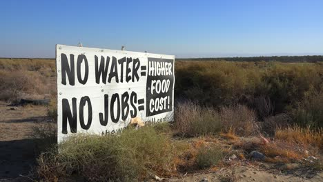 A-road-sign-warns-of-s-serious-drought-and-the-cost-to-California-in-jobs-and-food-1