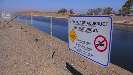 Signs-warn-people-to-stay-out-of-the-California-aqueduct