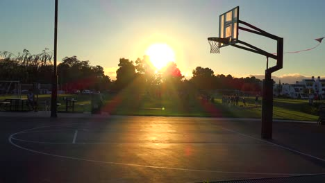 Teams-play-a-pickup-game-at-a-local-park-at-sunset