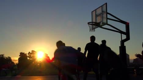 Teams-play-a-pickup-game-at-a-local-park-at-sunset-1