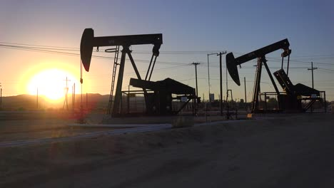 Oil-derricks-pump-against-the-sunset